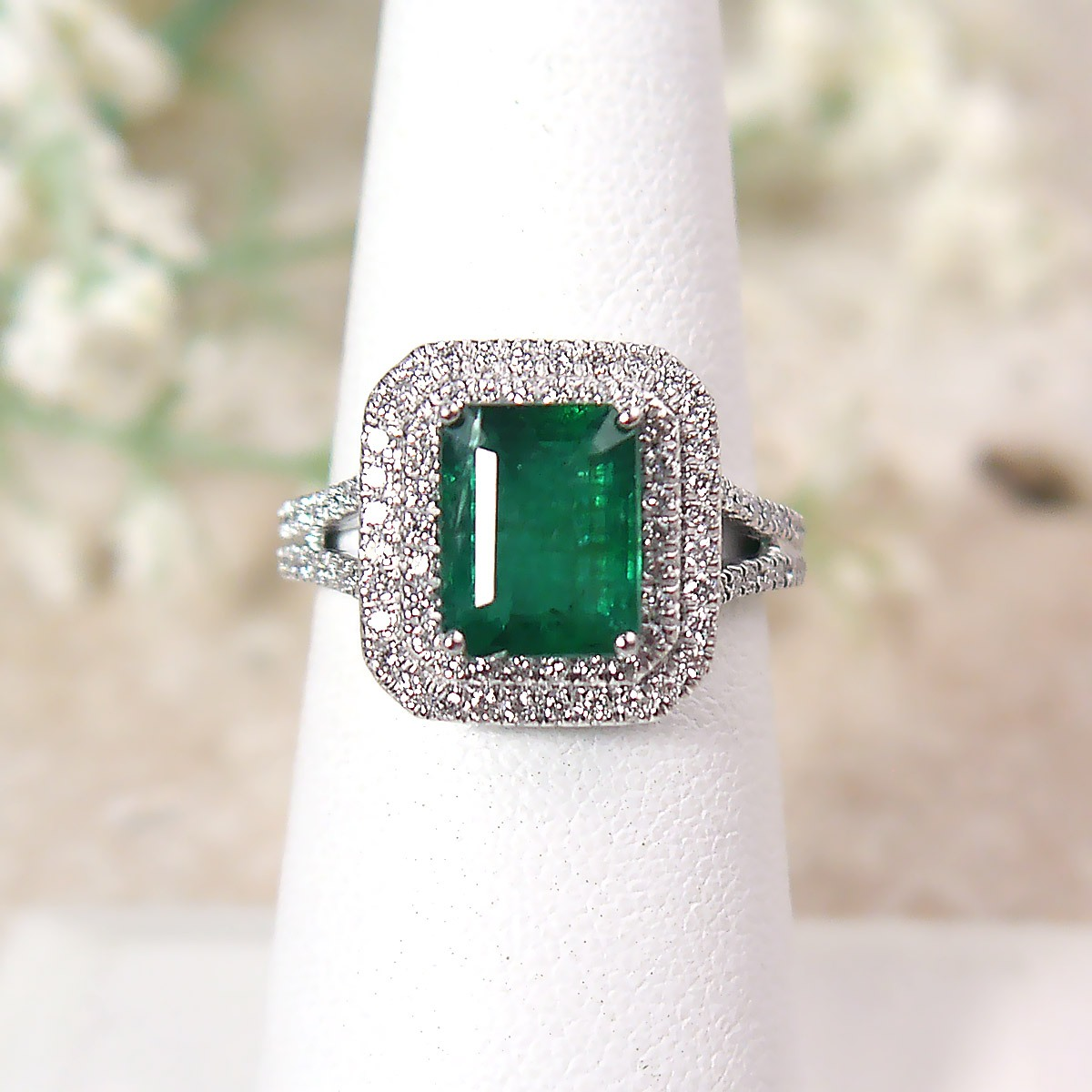 Emerald Cut Natural Emerald and Diamond Double Halo Ring in Platinum