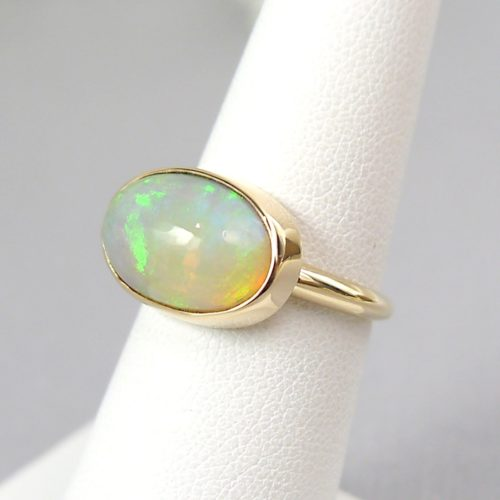 14k Handmade Bezel Ring with Oval Ethiopian Opal Cabochon in Yellow Gold